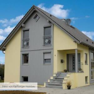 Haus von Karlburger Holzbau gelb und grau